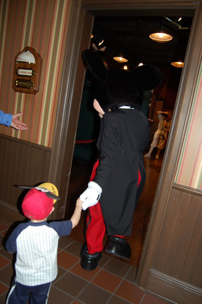 To keep your kids safe at Disney World, hold their hand.
