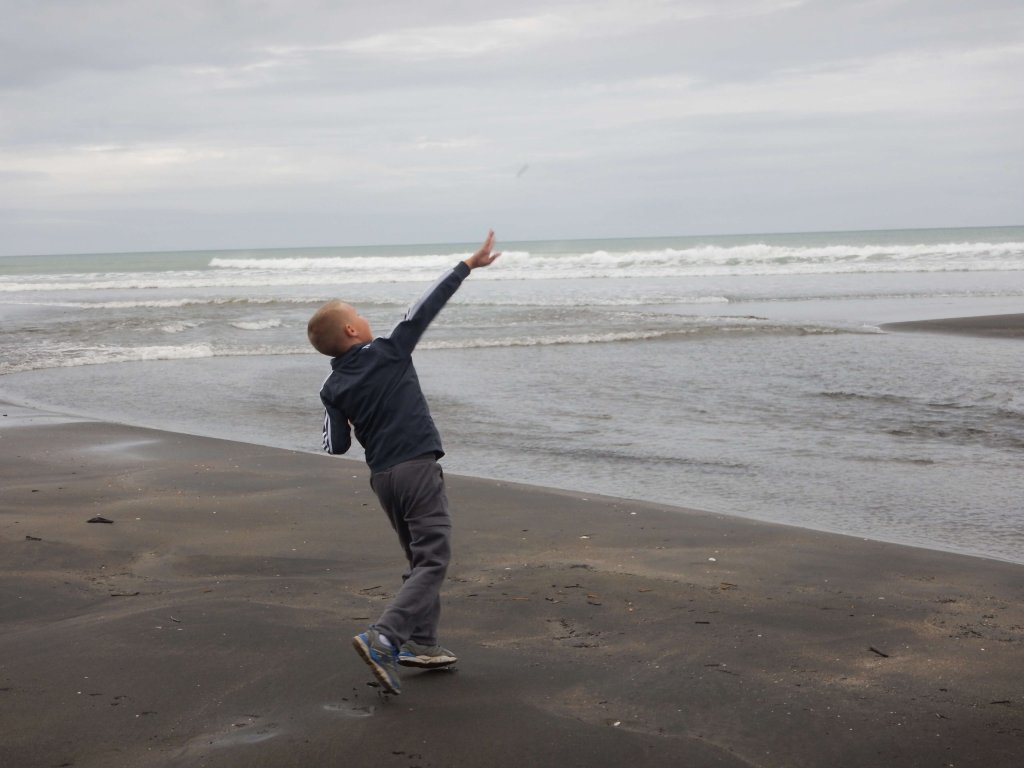My son on the black sand beach in New Zealand.