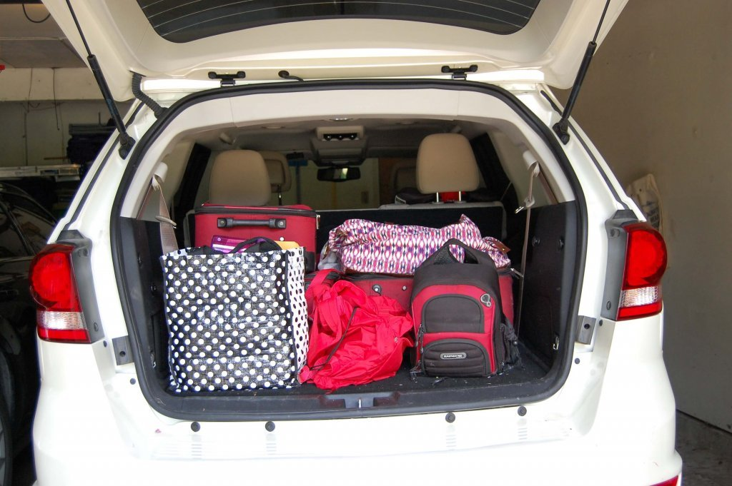 the back of a car packed with luggge