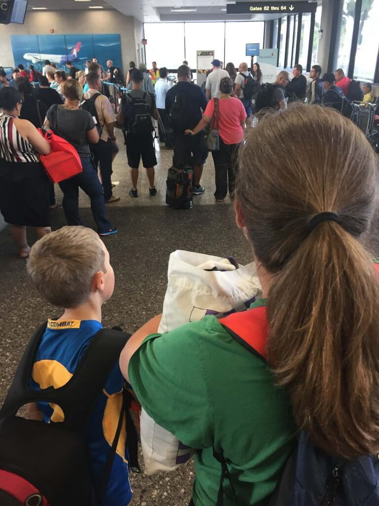A woman and a child walking through the airport